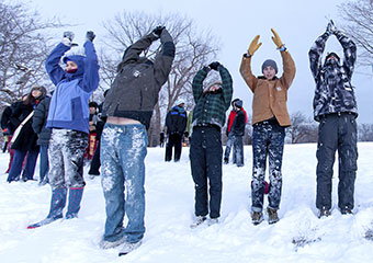 UChicago students perform sun salutations at the lakefront.