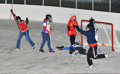 Alper and Crown Houses compete in broomball