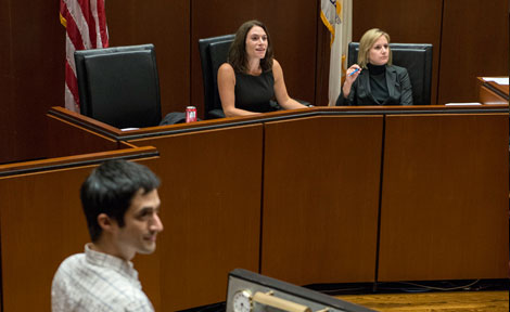A third-year law student practices his argument in the moot courtroom