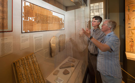 Janet Johnson and Brian Muhs look at a scroll written in Demotic at the Oriental Institute