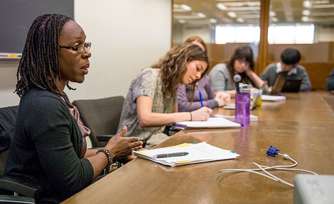 "Rachel Jean-Baptiste (far left), assistant professor of History, teaches a Chicago Studies class titled ""African Women in Chicago"""