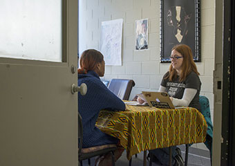 Masters candidate Kat Lea, right, interviews Leya Nunwan, from the Democratic Republic of the Congo,