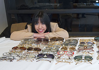 Janice Guzon with dozens of pairs of used eye glasses collected at St Isidore Church Sunday, Feb. 24, 2013, in Bloomingdale, Ill.