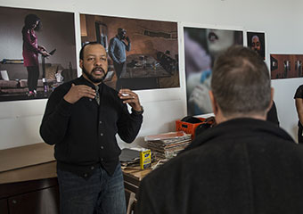 Photographer and artist-in-residence Cecil McDonald Jr., gives a tour of his work space at the newly-opened Arts Incubator