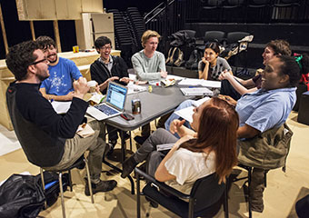 Director Evan Linder, left, from the New Colony, rehearses with TAPS students clockwise at the table from Linder: Bobby Huggins, stage manager; Martin So; James Fleming; Scarlett Kim; Zev Hurwich, and Ayode'le' Jolibois.