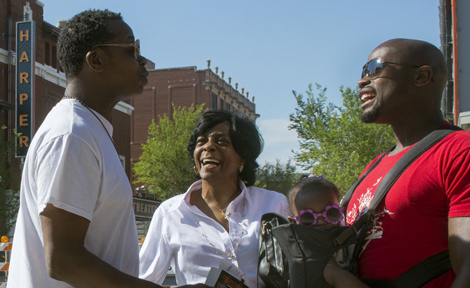 Hyde Park residents chat on 53rd Street in Chicago