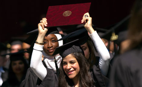 A UChicago student with diploma at Convocation 2012