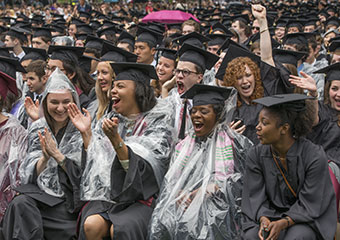 UChicago College graduates celebrate in the rain