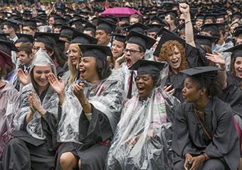 UChicago College graduates celebrate in the rain