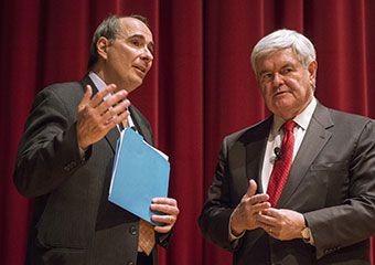 Newt Gingrich talks with David Axelrod, director of the University of Chicago's Institute of Politics, following their political discussion at Mandel Hall in February.