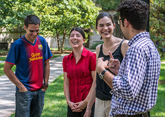UChicago grad students from left; Andrew Langford from the Divinity School; Michael Werner from Molecular Biology; Andrea Harris Jordan studying Music; Erin Nerstad studying English; and Fabian Arzuaga studying Political Science, take a break from a teach