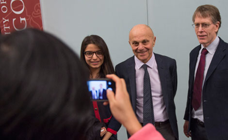 UChicago Prof. Eugene Fama and Lars Hansen pose with a student