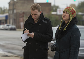 Harris School alum Jocelyn Hare works with Eric Baxter collect data for a land parcel survey in Gary, Ind.