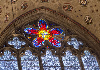 The stained glass rose window, called the cinquefoil, over the reredos, or back, of Rockefeller Memorial Chapel.