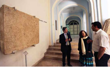Oriental Institute and National Museum curators discuss a Bactrian inscription