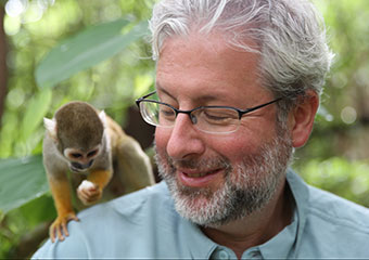 Neil Shubin feeds a squirrel monkey on his shoulder at the Monkey Jungle in Miami, Florida. Shubin is host of YOUR INNER FISH, which premieres on PBS April 9, 2014, at 10 PM (check local listings).