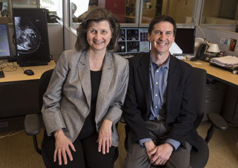 Maryellen L. Giger, Ph.D.,and John Flavin, executive director of the Chicago Innovation Exchange, at the Quantitative Insights office in the Polsky Institute