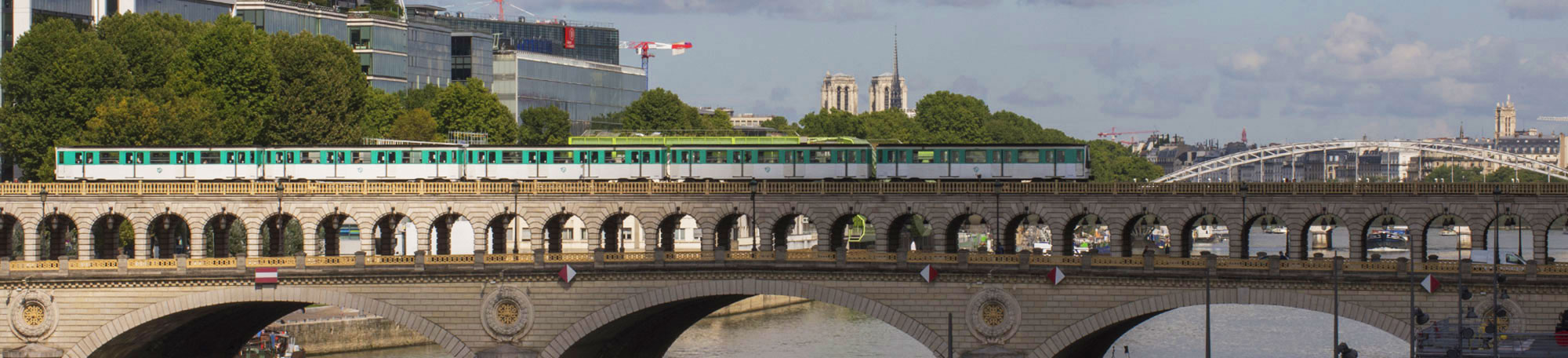 The Metro passes over Pont de Bercy near the University of Chicago's Center in Paris along the River Seine.