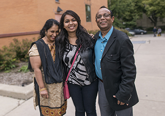 First year UChicago student Nushrat Jahan with her parents Reshma Begum, left, and Abdus Sarker, right.