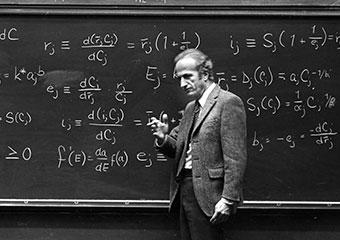 Gary S. Becker, AM'53, PhD'55, teaches at the blackboard