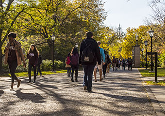 UChicago students make their way through Hull Court on campus.