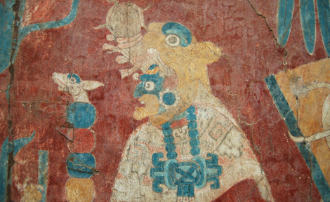 Mural of an old merchant god in the Cacaxtla acropolis