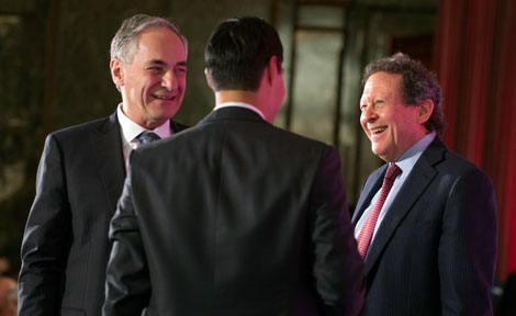 UChicago President Robert Zimmer with Tom Pritzker and HUD Secretary Julian Castro