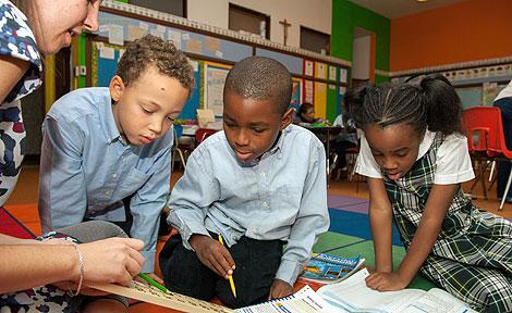 School children with Everyday Mathematics books