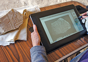 "An electronic stylus is used to make a ""pencil"" drawing on a digital image of an ancient Egyptian inscription"
