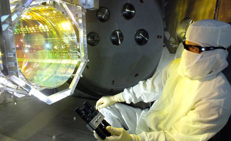 LIGO technician with optics