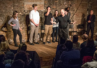 The Hutchins Plan performs improv at the Revival theater in Hyde Park