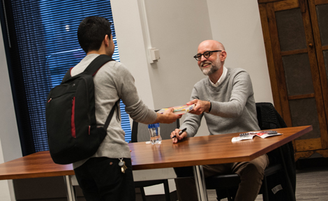 Clowes signing books