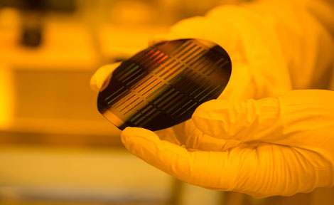 Peter Duda holds a pure silicon wafer