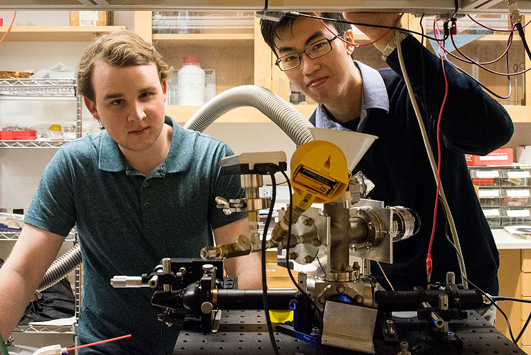 UChicago physics students Mykhaylo Usatyuk and Frankie Fung