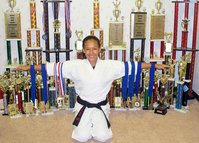 Jaida Kenana with trophies and medals