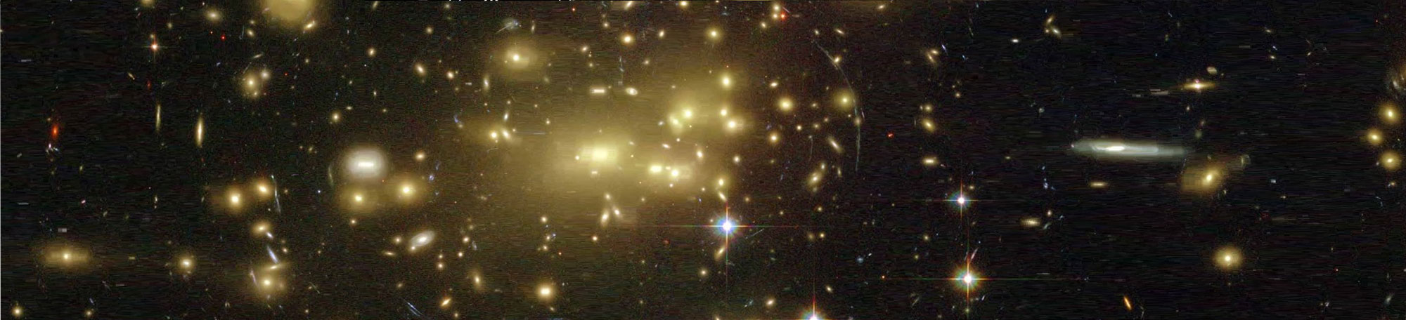 The gravity of galaxy cluster Abell 2218 bends and focuses the light from galaxies that lay behind it in this Hubble Space Telescope image. The effect distorts multiple images of the background galaxies into long, faint arcs. Credit and Copyright: NASA, A