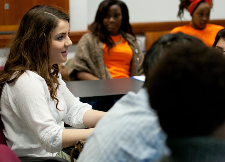 "Aklina Basic, a student at Whitney Young, speaks to a group at the ""Uprooting the War From Within"" Symposium at the University of Chicago on Saturday, March 23, 2013."