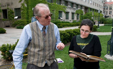 Professor Robert Morrissey discusses a passage of Les Misérables with student Benna Kesler.