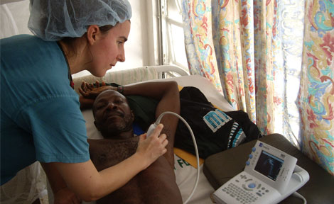Flora Waples, University of Chicago Senior Resident, performs cardiac ultrasound/echocardiography on a patient in the emergency department at John F. Kennedy Hospital in Monrovia, Liberia.