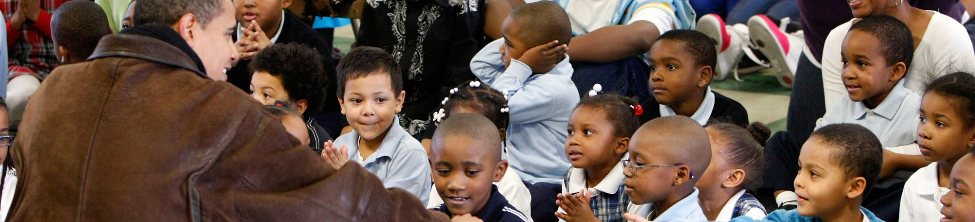 President Obama engages with young local children