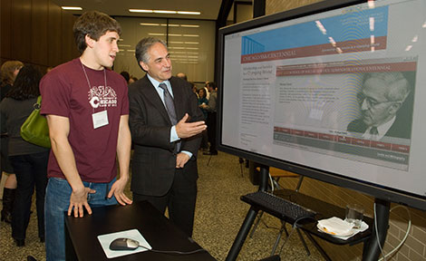 Sheridan Lardner, a second-year in the College, explores SSA's new interactive timeline with President Zimmer.