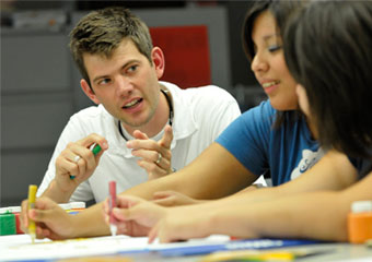 Andy Brake, SSA '08, helps students
